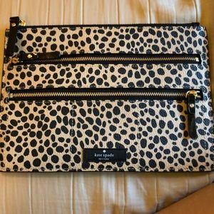 A Kate Spade toiletry purse